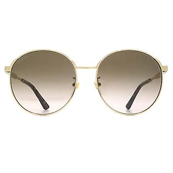 Gucci Metal Round Sunglasses In Gold Brown