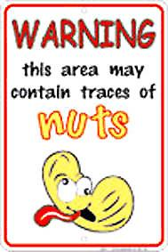 Warning May Contain Nuts embossed metal sign