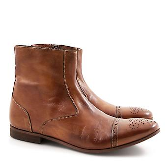 Women's perforated toe flat ankle boots in whisky leather