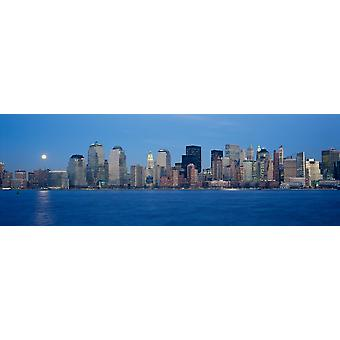 Panoramic view of full moon rising over lower Manhattan skyline NY where World Trade Towers were located Poster Print