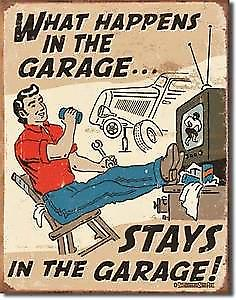 What Happens In The Garage (man on chair)... funny metal sign (fd)