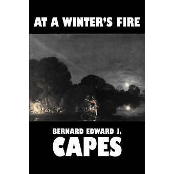 At a Winters Fire by Bernard Edward J. Capes Fiction Horror by Capes & Bernard Edward J.