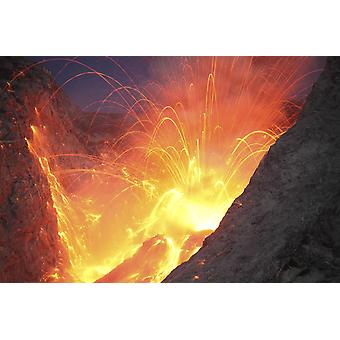 November 26 2012 - Explosive strombolian type eruption of Batu Tara volcano Komba Island Indonesia Trajectories of red glowing lava bombs are visible Poster Print