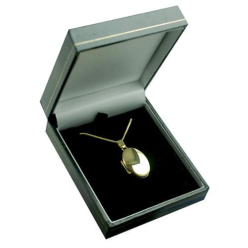 18ct Gold 22x15mm oval plain Locket with a curb Chain 16 inches Only Suitable for Children