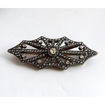 Antique silver on gold brooch with rose cut diamonds