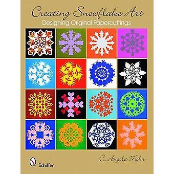 At skabe snefnug kunst - designe oprindelige Papercuttings af C. Angela