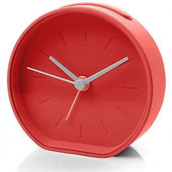 Red Lexon Beside Analogue Alarm Clock