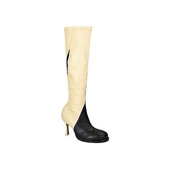 Céline knee high boots in black/off white soft leather