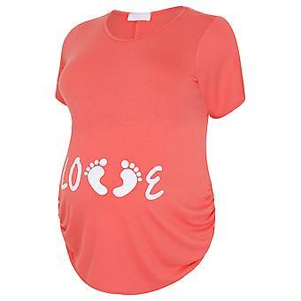 IL bosse en maternité haut corail avec une impression de « Love » blanc paillettes