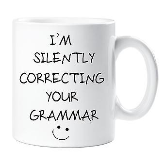 Ich bin still Ihre Grammatik Becher korrigieren.