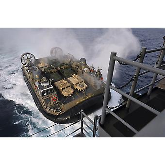 East China Sea February 2 2013 Landing Craft Air Cushion approaches the well deck of the forward-deployed amphibious assault ship USS Bonhomme Richard Poster Print