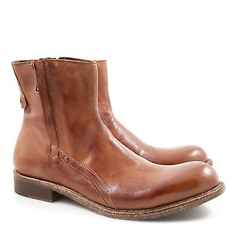 Handmade men's ankle boots in whisky color leather