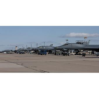 A long line up of 7th Bomb Wing B-1B Lancers on the ramp at Dyess Air Force Base Texas Poster Print