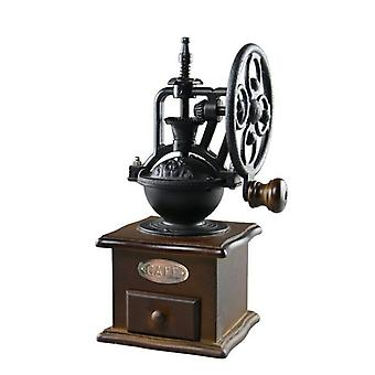 Manual ceramic coffee grinder in cast iron and wood