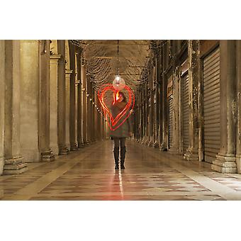 A woman walking in a corridor making a red heart shape in the air with light trails Venice Veneto Italy PosterPrint
