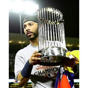 Marwin Gonzalez with the World Series Championship Trophy Game 7 of the 2017 World Series Photo Print