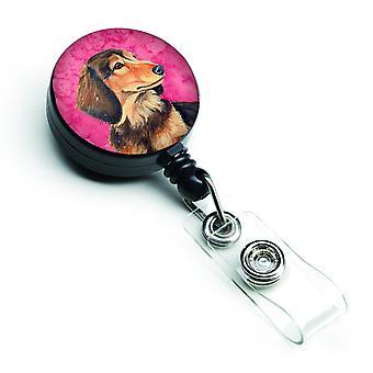 Carolines tesoros LH9391PKBR Dachshund rosado insignia Retractable carrete