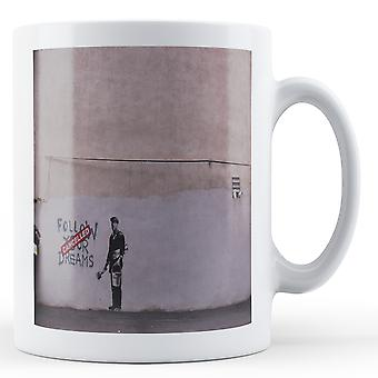 Printed mug featuring Banksy's, 'Follow your Dreams 2' artwork