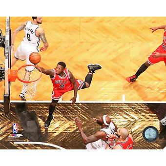 Nate Robinsion #2 of the Chicago Bulls shoots a layup against the Brooklyn Nets in Game Two of the Eastern Conference Quarterfinals Photo Print