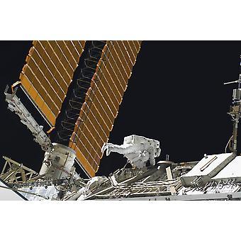 Astronauta partecipa in attività extraveicolare Poster Print