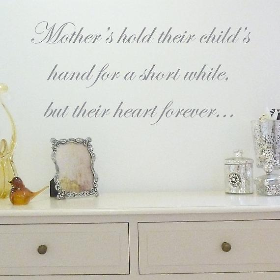 Mother holds their child's hand wall quote