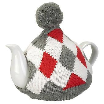 Teapot with knitted cover Pane