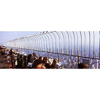 Tourists at an observation point Empire State Building Manhattan New York City New York State USA Poster Print