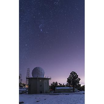 A defunct Air Force Station radar tower still stands at Mount Lemmon Observatory near Tucson Arizona The constellation Orion floats above this remnant from the Cold War Poster Print
