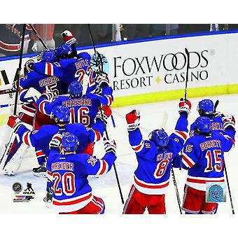The New York Rangers celebrate after defeating the Montreal Canadiens in Game Six to win the Eastern Conference Finals of the 2014 NHL Stanley Cup Playoffs at Madison Square Garden on May 29 2014 Phot
